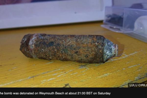 Weymouth woman 'threw unexploded WW2 bomb across garden'