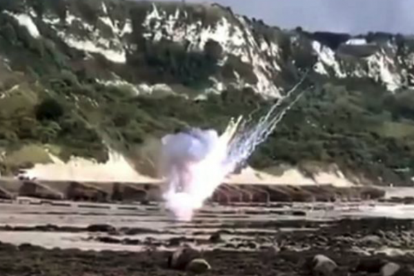 Dad and his two sons discover WWII UXO during stroll at a beach